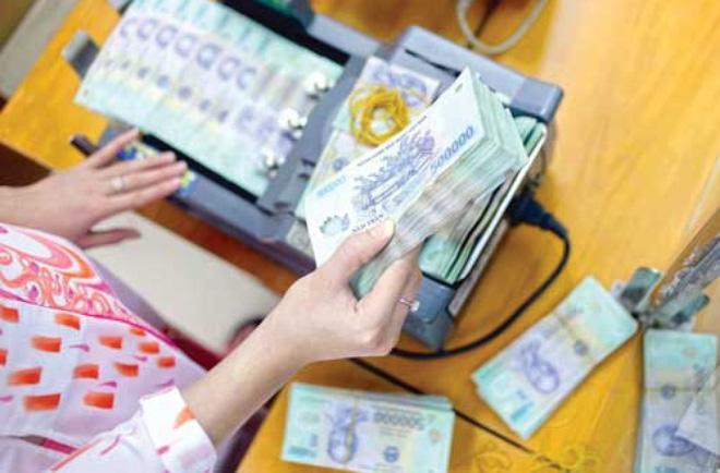 Lợi nhuận và áp lục nợ xấu
