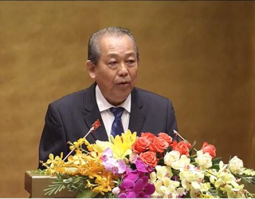 Phó Thủ tướng Thường trực Chính phủ Trương Hòa Bình báo cáo trước Quốc hội